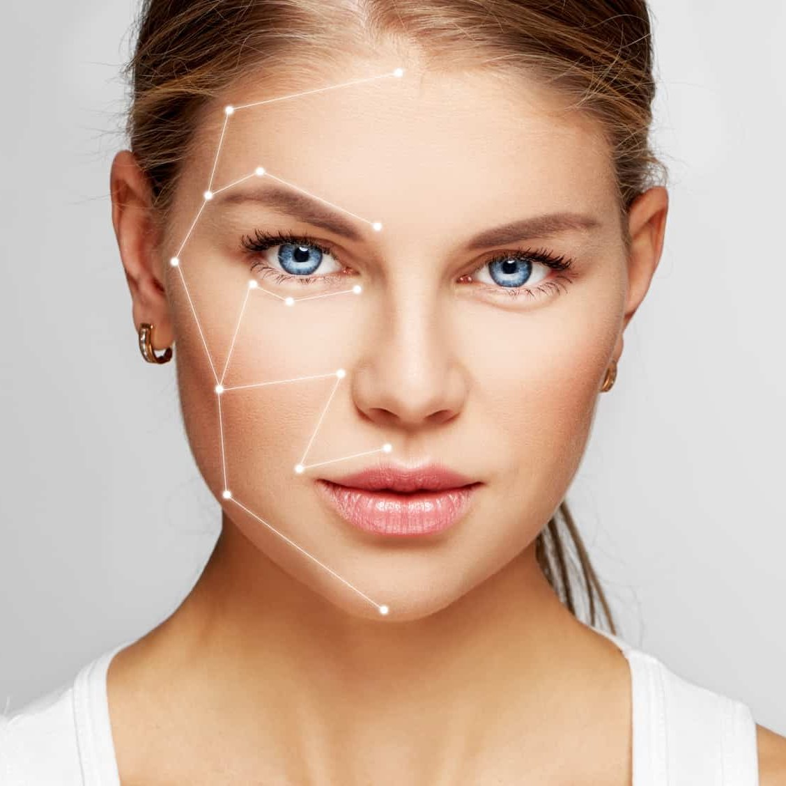 Skin care and technology. Portrait of beautiful woman face with